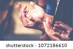 soft focus  praying and praise... | Shutterstock . vector #1072186610