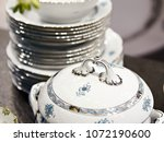 tureen and a stack of plates | Shutterstock . vector #1072190600