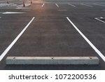parking stalls in a parking lot ... | Shutterstock . vector #1072200536