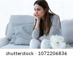 shot of thoughtful young woman... | Shutterstock . vector #1072206836