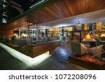 modern restaurant terrace in... | Shutterstock . vector #1072208096