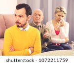 aged parents arguing with their ... | Shutterstock . vector #1072211759