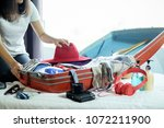 people packed suitcase with... | Shutterstock . vector #1072211900