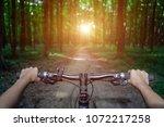 mountain biking down hill... | Shutterstock . vector #1072217258