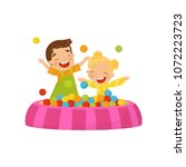 happy boy and girl playing in a ... | Shutterstock .eps vector #1072223723