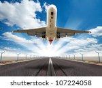 big jet plane taking off runway | Shutterstock . vector #107224058