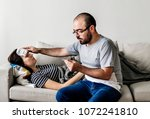couple sick at home on the sofa | Shutterstock . vector #1072241810