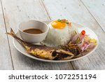 fried fish with rice with... | Shutterstock . vector #1072251194