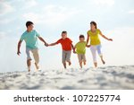 photo of happy family running... | Shutterstock . vector #107225774