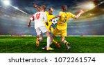 soccer ball on the field of... | Shutterstock . vector #1072261574