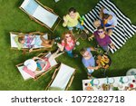 a group of friends looks up and ... | Shutterstock . vector #1072282718
