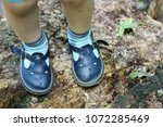 cute toddlers feet in retro... | Shutterstock . vector #1072285469