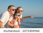 happy family standing on the... | Shutterstock . vector #1072304960