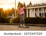 a young woman is riding a... | Shutterstock . vector #1072347329
