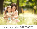 happy mother and daughter in... | Shutterstock . vector #107236526