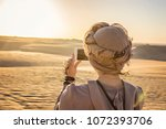 young woman wearing turban ... | Shutterstock . vector #1072393706