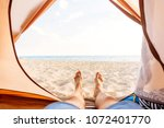 young man resting in a tent on... | Shutterstock . vector #1072401770