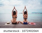 beautiful women doing yoga at... | Shutterstock . vector #1072402064