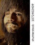 a primitive iceman portrait | Shutterstock . vector #1072402409