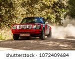 Small photo of TUSCAN REWIND RALLY, MONTALCINO, ITALY - MAY 11, 2013: Motorsport Action PORSCHE 911 SC SAFARI