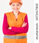 Small photo of Woman on happy smiling face in builders uniform, white background. Female worker with helmet on head. Happy worker concept. Architect, engineer, builder with protective hard hat on head.