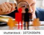 Man In Suit Look Thru Loupe On...