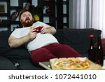 happy fat man in dirty shirt...   Shutterstock . vector #1072441010