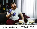 fat man doing sport while he... | Shutterstock . vector #1072441058