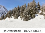 a wintertime view on mt. titlis ... | Shutterstock . vector #1072443614