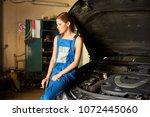 the girl leaned against the... | Shutterstock . vector #1072445060