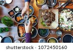 sharing good food and wine with ...   Shutterstock . vector #1072450160