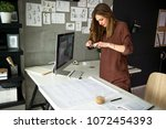documenting a finished job | Shutterstock . vector #1072454393