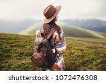 traveler hipster girl in hat... | Shutterstock . vector #1072476308