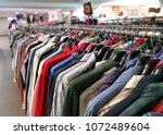 second hand shirts for sale in... | Shutterstock . vector #1072489604