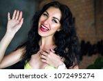 close up sunny positive... | Shutterstock . vector #1072495274
