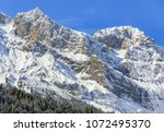 mountain summits against blue... | Shutterstock . vector #1072495370