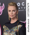 los angeles   apr 18   charlize ... | Shutterstock . vector #1072507679