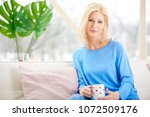 beautiful smiling woman holding ...   Shutterstock . vector #1072509176