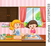sister cleaning dishes in...   Shutterstock .eps vector #1072509233