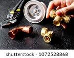 concept plumbing tools on dark... | Shutterstock . vector #1072528868