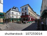 PARIS, FRANCE - MAY 19: The charming streets of Montmartre hill are full of art galleries, cafes and shops to walk about. It's one of the most visited landmarks in Paris. May 19, 2011 in Paris, France - stock photo