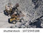 heavy mining excavator loads... | Shutterstock . vector #1072545188