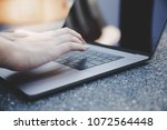 closeup working and typing... | Shutterstock . vector #1072564448