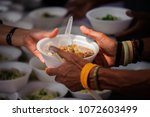 Feeding The Poor To Hands Of A...