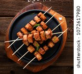 grilled meat skewers  shish... | Shutterstock . vector #1072617980