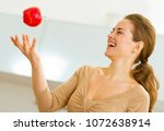 young woman throwing apple in... | Shutterstock . vector #1072638914