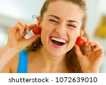 smiling young woman using... | Shutterstock . vector #1072639010