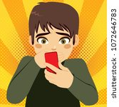 teenager boy with hand on mouth ... | Shutterstock .eps vector #1072646783