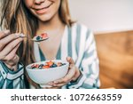 crop woman close up eating oat... | Shutterstock . vector #1072663559