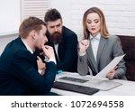 business partners  businessmen... | Shutterstock . vector #1072694558